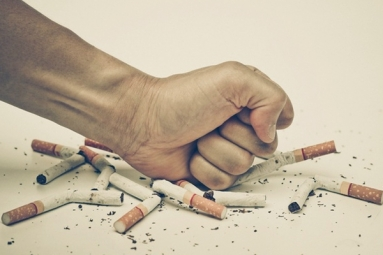 Negative Social Cues on Tobacco Packages May Help Smokers Quit