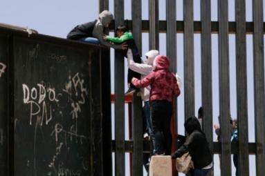 Video Clip Shows Punjabi Women, Children Crossing Border Fence into U.S.